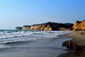 waves surfacing at Playa Canoa in Ecuador