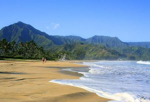 Lush green mountains surrounding one of the best beaches in Hawaii, Hanalei Bay