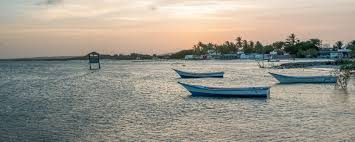 Boats floating on the waters at sunset on El Yaque in Venezuela