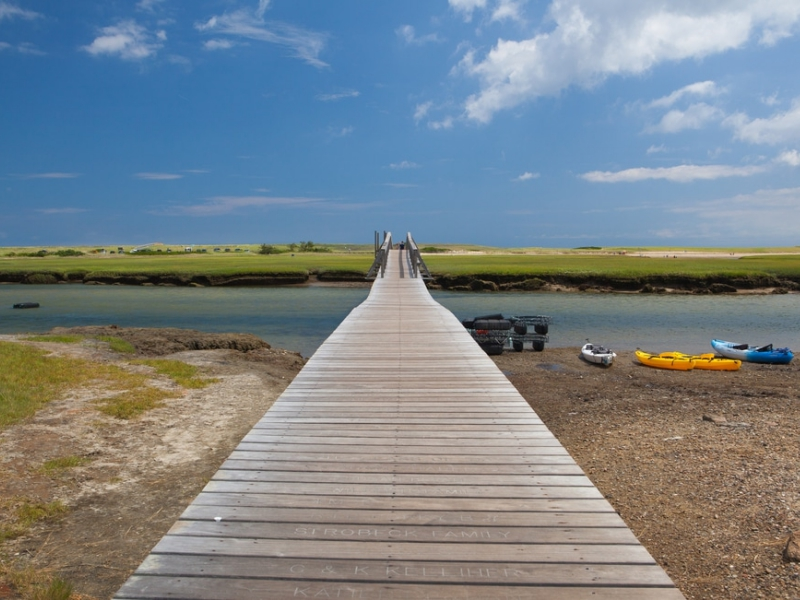 A long boardwalk leads to the active Town Neck Beach