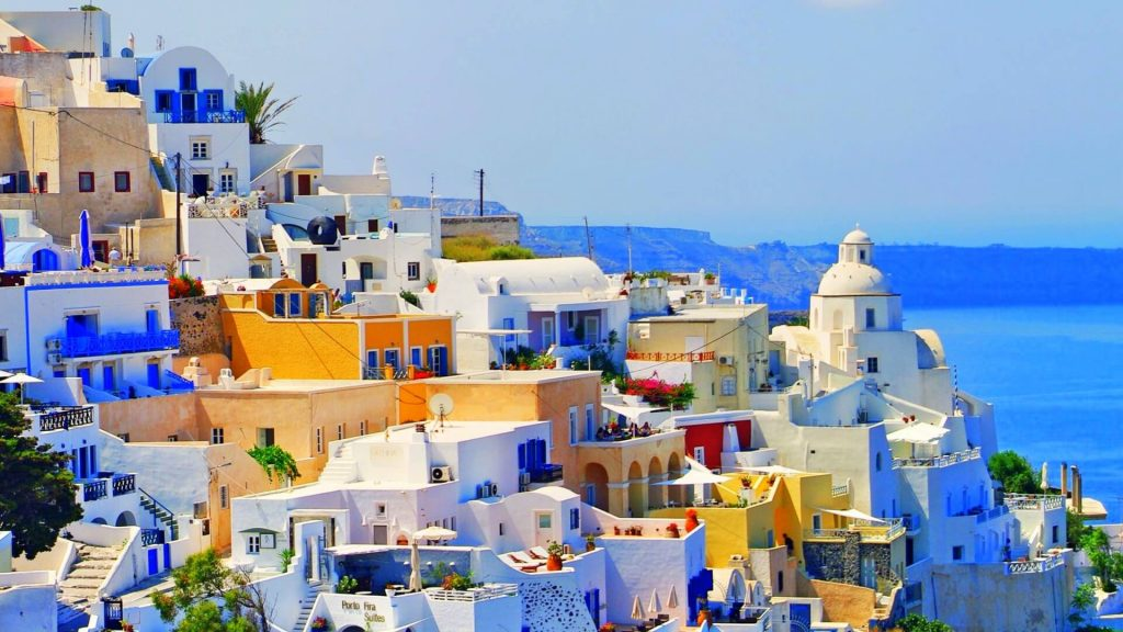 View of the colorful buildings near coastal Greece