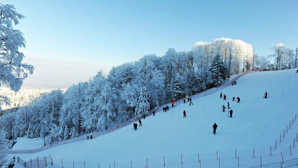 The Sljeme Ski Resort has its slopes covered in white snow as skiiers make their way down the tracks in January (Jan)