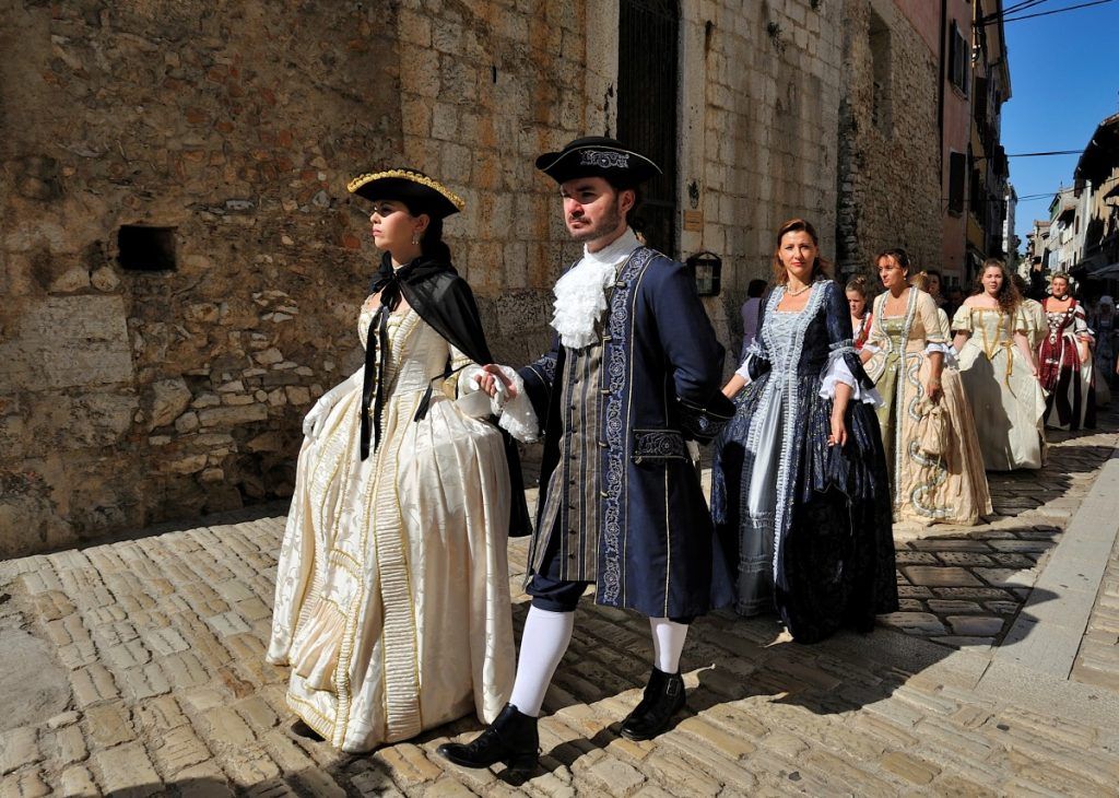 A procession of participants in the Giostra Festival dressed up in 18th-century clothes in Porec during the month of September (Sep)