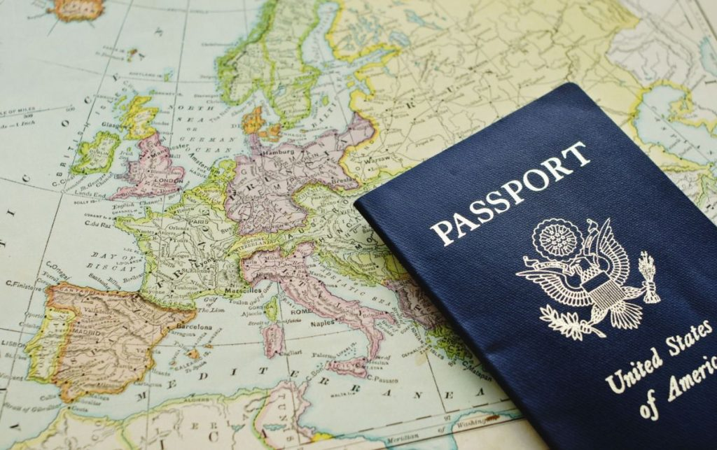 An American passport on a map