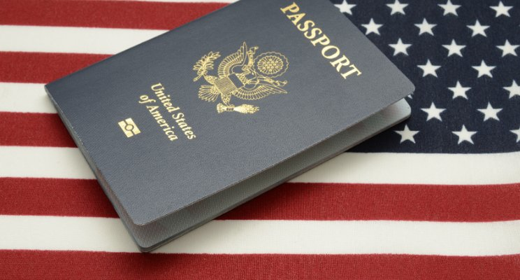 US Passport with an American flag