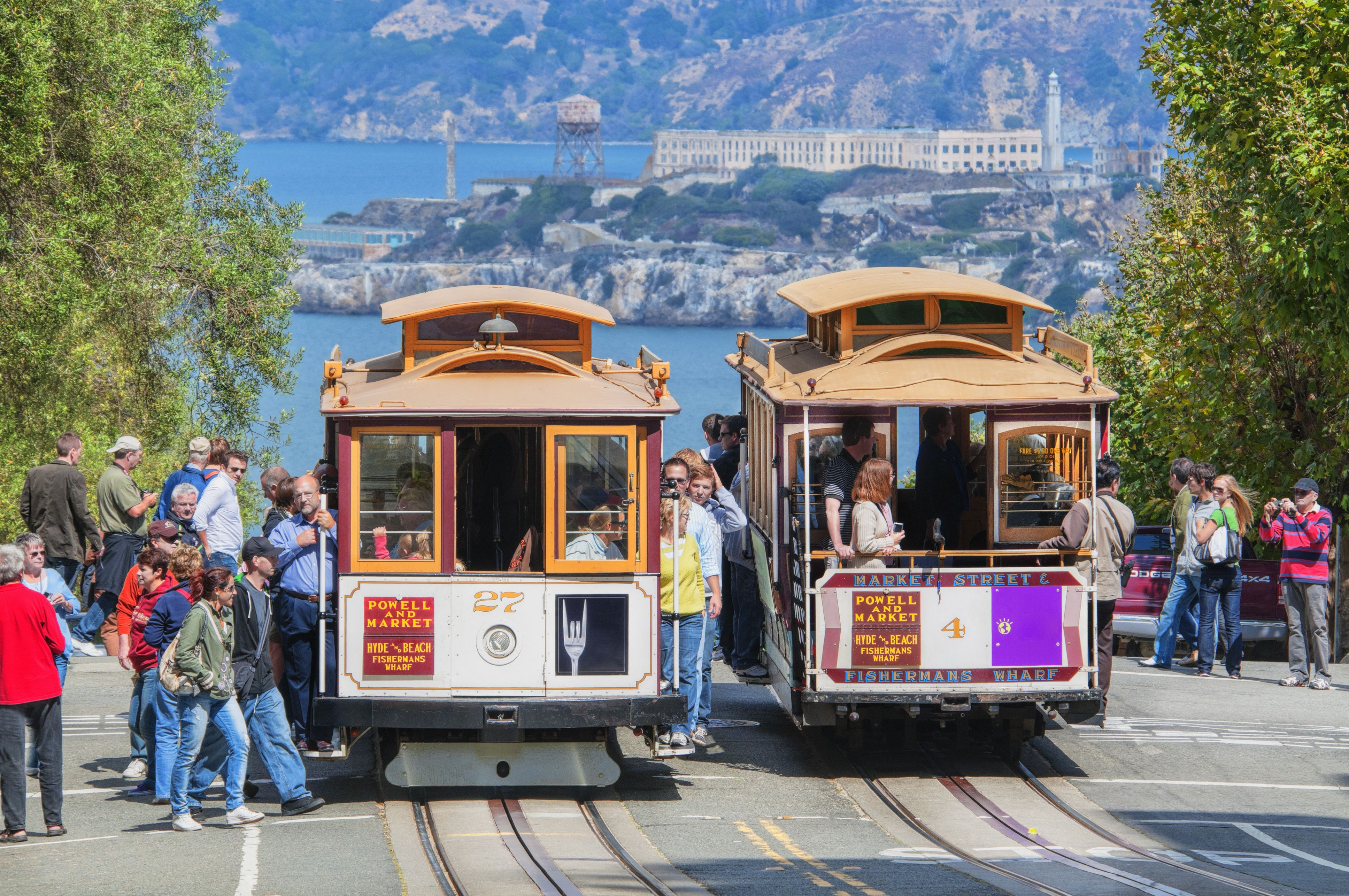 The San Francisco cable cars go up and down the San Francisco hills during the sunny month of September
