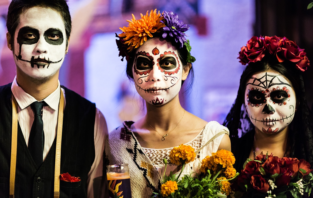 The Dia de Los Muertos is celebrated by traditional Mexican imagery and makeup when people go to pay their respects to their dead loved ones