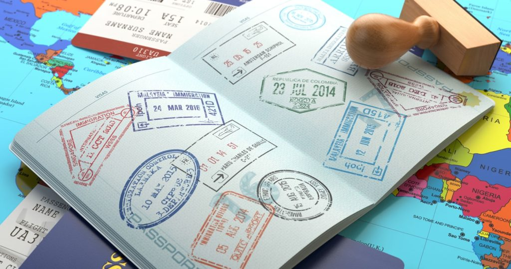 A passport with visa stamps all over the two pages displayed