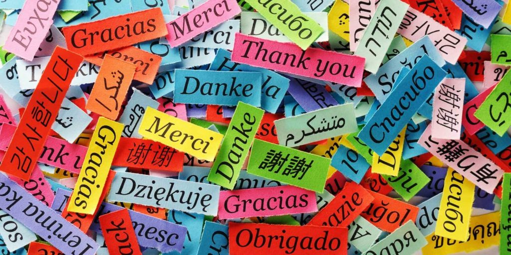 The word thank you written in different languages all in different colors