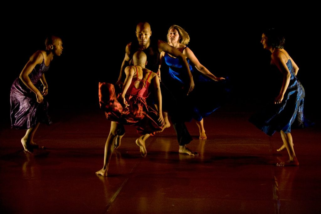 A group of dancers perform on stage for the National Arts Festival in Grahamstown