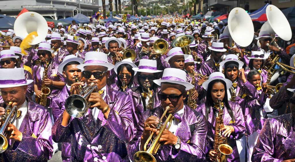 Bands dressed in purple, flashy clothes march through Cape Town at the beginning of the New Year to celebrate Kaapse Klope